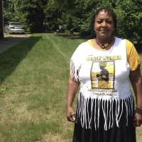 Deborah Chenault Green on July 6 discusses Detroit's 1967 riots from a vacant lot where her cousin's home once stood on the city's west side. Green, 62, was 12 years old and spending the night at the home when the riot started on July 23, 1967. 'The national guard was going into people's houses,' Green said. 'I could remember the first time I heard a tank coming down 12th Street. It scared us to death because it shook everything. I always heard shooting during that time. During the riots was the first time we learned how to hit the floor when we heard gunfire.' | AP
