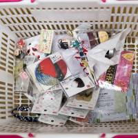 Products that cost ¥100 each sit inside a customer's basket at a Daiso store, operated by Daiso Sangyo Corp., in the Harajuku area of Tokyo on June 30. | BLOOMBERG