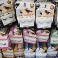 Fake eyelashes are displayed for sale at a Daiso store in Harajuku. | BLOOMBERG