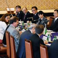 Ministerial members in charge of the free trade negotiations between Japan and the European Union tackle the issues Sunday in Tokyo. | POOL / VIA KYODO