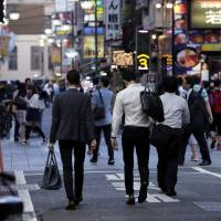 Japan's short labor supply adds to signs of economic recovery, but may constrain further growth