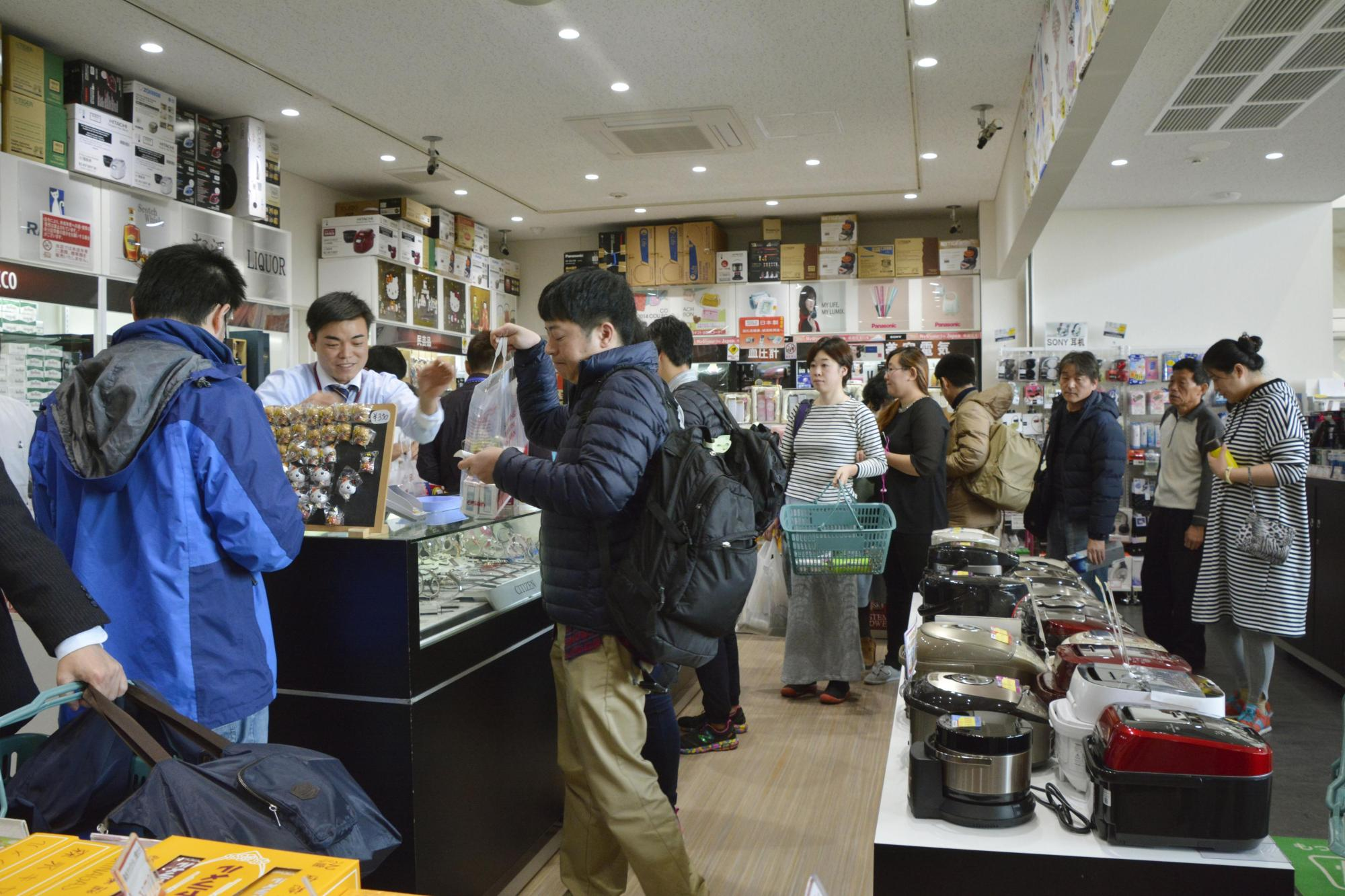 Tourists shop at Saga airport in Saga Prefecture. The transport ministry has selected a number of regional airports to take part in a tourism promotion incentive program.   KYODO