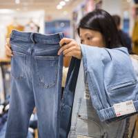 Consumer spending data provide encouraging signs Japan's economy, but inflation remains tepid