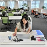 Japanese firms give telecommuting a try on designated day to ease rush hour congestion