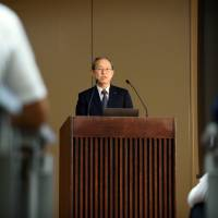 Satoshi Tsunakawa, president and CEO of Toshiba Corp., speaks at a Tokyo news conference on June 23.   BLOOMBERG