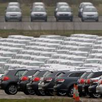 New cars sit parked at Toyota's Burnaston plant near Derby, central England.   REUTERS