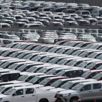 Toyota vehicles bound for export sit in a lot at Nagoya port in Aichi Prefecture. | BLOOMBERG