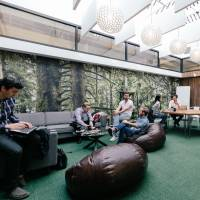 The West Broadway Lounge, one of many co-working locations in New York run by WeWork, is seen in a press image. | WEWORK