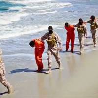 A screen shot from video released by Islamic State militants in April 2015 shows a group of captured Ethiopian Christians taken to a beach before they were killed by extremists in Libya. | AP