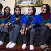 Afghanistan's FIRST Global Challenge team meets with reporters following the opening ceremony in Washington Sunday. Twice rejected for U.S. visas, the all-girls robotics team competes against entrants from more than 150 countries in the FIRST Global Challenge. It's the first annual robotics competition designed to encourage youths to pursue careers in math and science. | AP