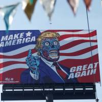 A billboard of U.S. President Donald Trump as a 'They Live'-style alien stands beside Periferico Avenue in Mexico City on Friday. | REUTERS