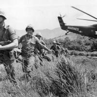 U.S. Marines stream into a suspected Viet Cong village near Da Nang in Vietnam during the Vietnamese war in 1965. Filmmaker Ken Burns said he hopes his 10-part documentary about the War, which begins Sept. 17 on PBS, could serve as sort of a vaccine against some problems that took root during the conflict, such as a lack of civil discourse in America. | AP