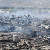 Fire reduces Syrian refugee camp to ashes in Lebanon; one dead