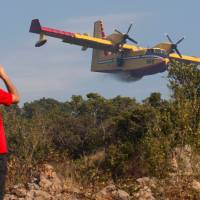 Firefighting planes keep flames away from Dubrovnik resort but other Croatia blazes rage on