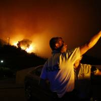 Wildfires force evacuations, rip through forests in southern France, Corsica