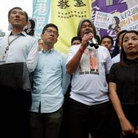Protesters gather after Hong Kong's High Court disqualifies four lawmakers from parliament
