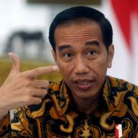 Indonesian President Joko Widodo gestures during an interview with Reuters in Jakarta Monday. | REUTERS