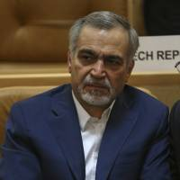 Hossein Fereidoun, brother and top aide of moderate Iranian President Hassan Rouhani, sits in a conference in Tehran on July 3. The semi-official Tasnim news agency reported on Sunday that Hossein Fereidoun has been detained over financial matters. | AP