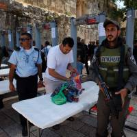 Israel reopens sensitive holy site in Jerusalem after attack, but Muslims refuse to enter
