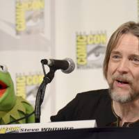 Kermit the Frog (left) and puppeteer Steve Whitmire attend 'The Muppets' panel on day 3 of Comic-Con International in San Diego in 2015. ABC News and The Hollywood Reporter reported Monday that Whitmire is no longer performing the character. | TONYA WISE / INVISION / VIA AP