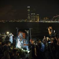 Liu Xiaobo supporters mark his death amid concerns for widow