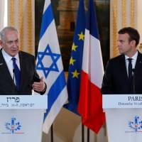 Macron decries France's Holocaust legacy during Netanyahu visit, hits Israeli settlements