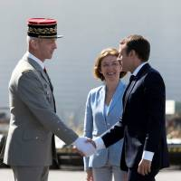 Macron tries to mend fences after rebuke prompts military chief to resign