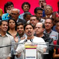 Freddy Guevara, first vice-president of the National Assembly and lawmaker of the Venezuelan coalition of opposition parties (MUD), talks to the media during a news conference in Caracas Monday. | REUTERS