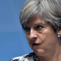 Weakened May appeals to opponents to help deliver Brexit success