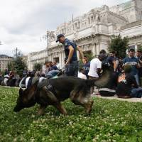 Milan police collar dozens of migrants in sweep of main train station