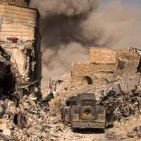 Islamic State holdouts fight on in west Mosul in battle Amnesty calls 'civilian catastrophe'