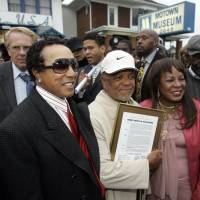 Berry Gordy Jr. is flanked by Smokey Robinson and Detroit Councilwoman Martha Reeves outside Hitsville U.S.A. and the Motown Museum in Detroit in 2007. Gordy was honored with the renaming of the street where the Motown sound originated. Motown was near the epicenter of the 1967 riots but largely spared during unrest that enveloped 25 city blocks and claimed 43 lives. | AP