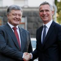 Pledging reforms by 2020, Ukraine seeks road map to NATO membership
