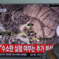 A man watches a TV news program reporting on North Korea's fifth nuclear test, at Seoul Railway Station in the South Korean capital on Sept. 9. | AP