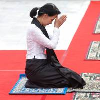 Myanmar State Counselor Aung San Suu Kyi attends an event marking the 70th anniversary of Martyrs' Day at the Martyrs' Mausoleum dedicated to the fallen independence heroes, including her father, Gen. Aung San, in Yangon on Wednesday. | REUTERS