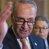 Senate Minority Leader Chuck Schumer, joined at right by Sen. Al Franken, criticizes the Republican health care bill during a news conference on Capitol Hill in Washington Tuesday.   AP