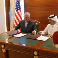 Tillerson inks apparently symbolic anti-terror deal with Qatar in bid to end row with its U.S. allies