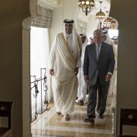 The Emir of Qatar, Sheikh Tamim Bin Hamad Al Thani, welcomes U.S. Secretary of State Rex Tillerson to Sea Palace, his official residence, in Doha, Qatar, on Tuesday.  Tillerson visited Qatar while trying to mediate a dispute between the energy-rich country and its Gulf neighbors. | AP