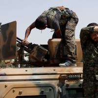 Casualties mount as U.S.-backed forces enter Syria's Raqqa from south