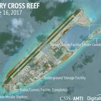 Construction is shown on Fiery Cross Reef in the Spratly chain of the disputed South China Sea in this June 16 satellite image. | CSIS / AMTI / DIGITAL GLOBE / HANDOUT / VIA REUTERS