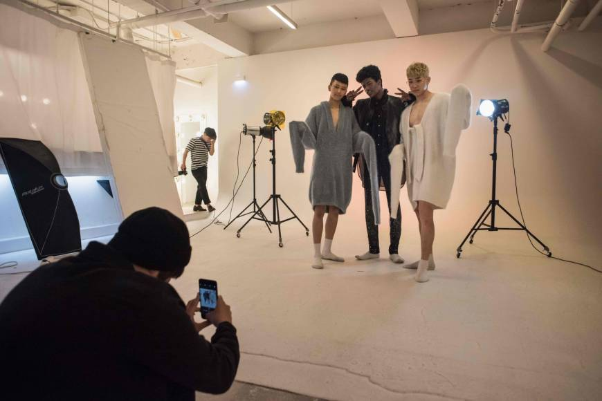 South Korean model Han Hyun-min poses with other models during a photo shoot at a studio in Seoul on Friday.