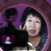 South Korean YouTube star Park Makrye, 70, gives a demonstration of makeup tutorials for her YouTube channel during an interview at her home in Yongin, South Korea, on Tuesday. | AP