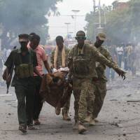 At least eight killed in al-Shabab attack on AU convoy in Somalia, five more in Mogadishu blast