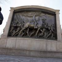 People walk past the memorial to Union Col. Robert Gould Shaw and the 54th Massachusetts Volunteer Infantry Regiment, near the Statehouse in Boston, in 2011. The sword that belonged to Shaw, the commanding officer of the first all-black regiment raised in the North during the Civil War, was recently found in the attic of a Boston-area home. | AP