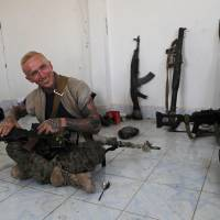 U.S., British volunteers battle Islamic State in militants' de facto Syrian capital