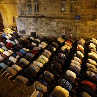 Thousands of Muslims stage prayer protest outside Jerusalem holy site despite Israel easing of security