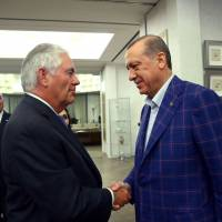 A handout picture taken and released Sunday by the Turkish Presidential Press Service shows Turkish President Recep Tayyip Erdogan (right) and U.S. Secretary of State Rex Tillerson during their meeting in Istanbul, as Turkey's Foreign Minister Mevlut Cavusoglu looks on. Tillerson was holding talks with Turkish leaders in Istanbul in a bid to iron out a series of disputes on issues ranging from Syria to last year's failed coup. | TURKISH PRESIDENTIAL PRESS SERVICE / HANDOUT / VIA AFP-JIJI