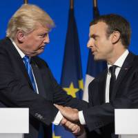 Trump hints he could reverse decision to exit Paris climate pact if persuaded