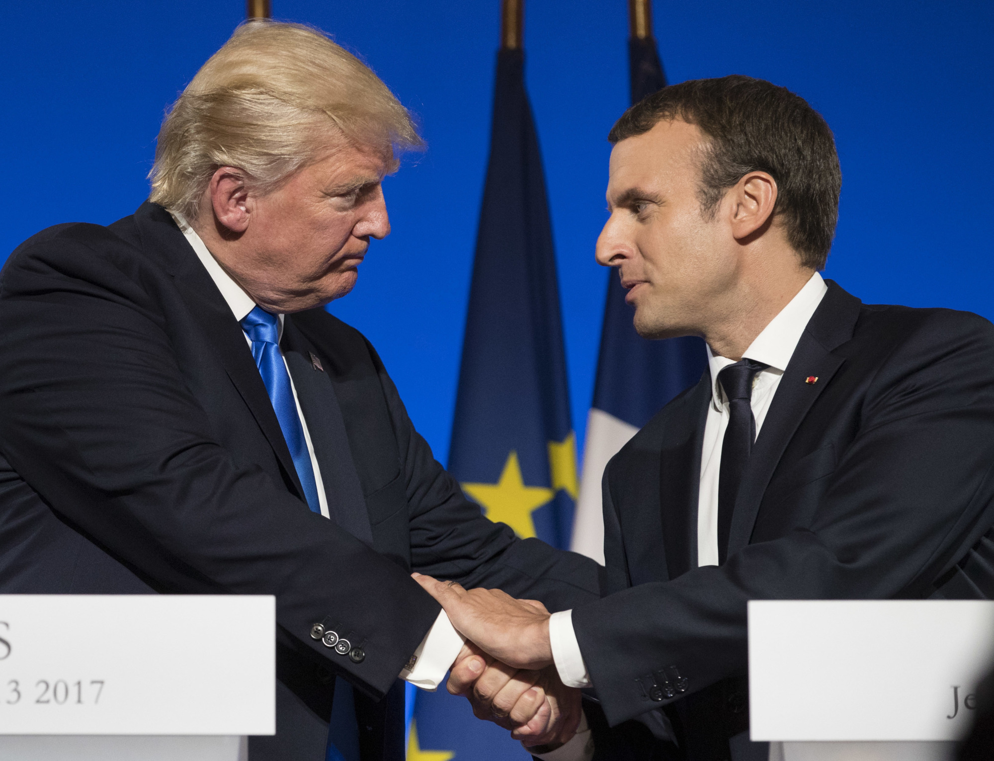 President Donald Trump and French President Emmanuel Macron conclude their joint news conference at the Elysee Palace in Paris Thursday. | AP