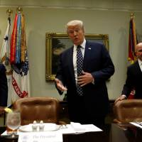 U.S. President Donald Trump, Vice President Mike Pence (left) and National Security Adviser H.R. McMaster arrive for a lunch meeting with service members at the White House in Washington Tuesday.   REUTERS